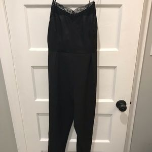 Black jumpsuit. Satin top and trouser type pants.